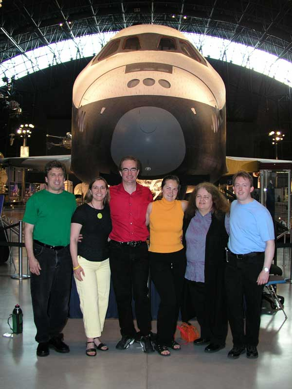 Chromatics pose with the Space Shuttle